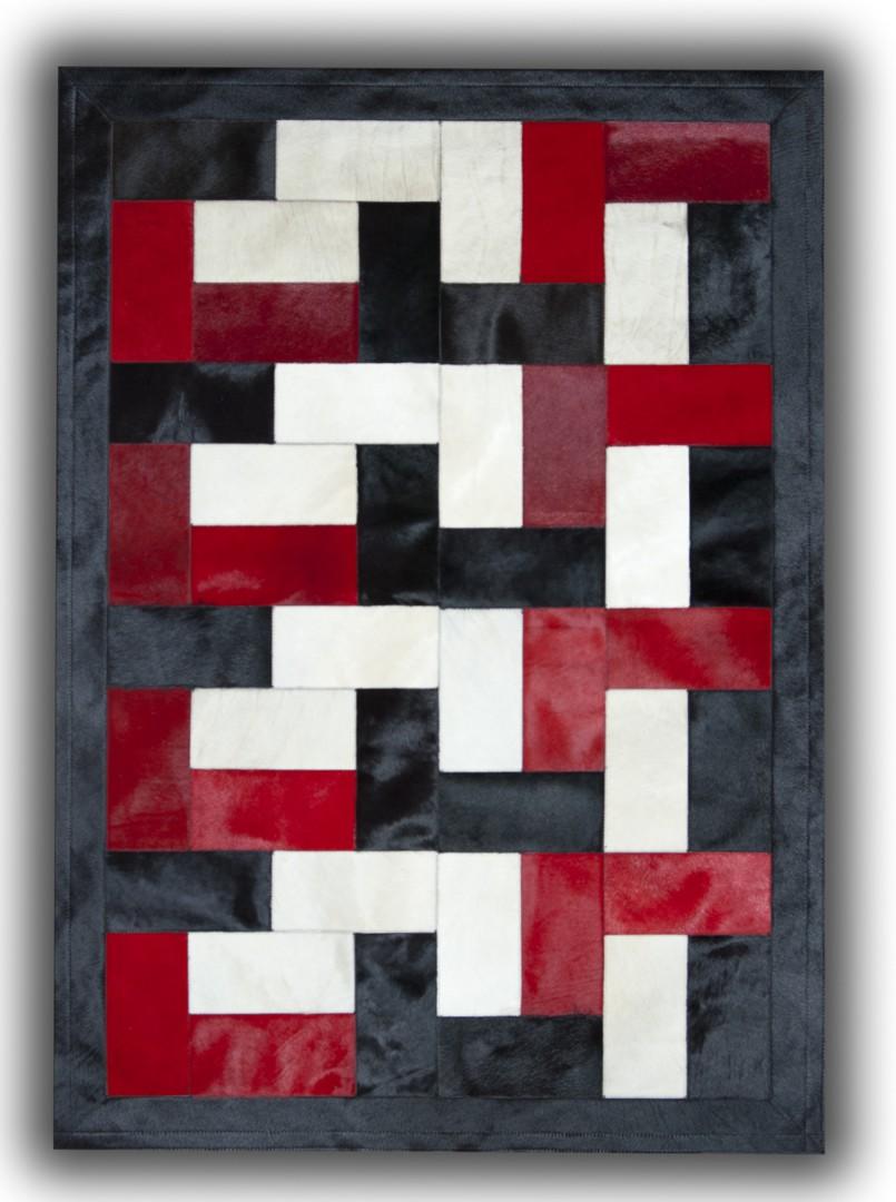 Tapis noir, blanc et rouge sur peau de vache patchwork Ceuta