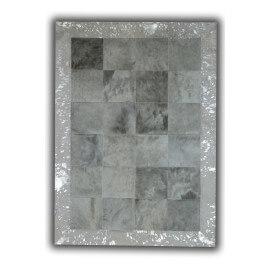 Tapis gris avec bord argenté sur peau de vache naturelle Sagonte