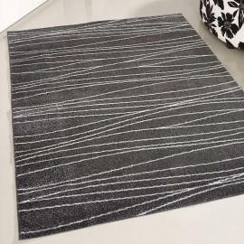 Tapis design gris courbe intérieur Triam
