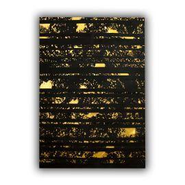 Tapis noir et or design plat en peau de vache naturel Santi